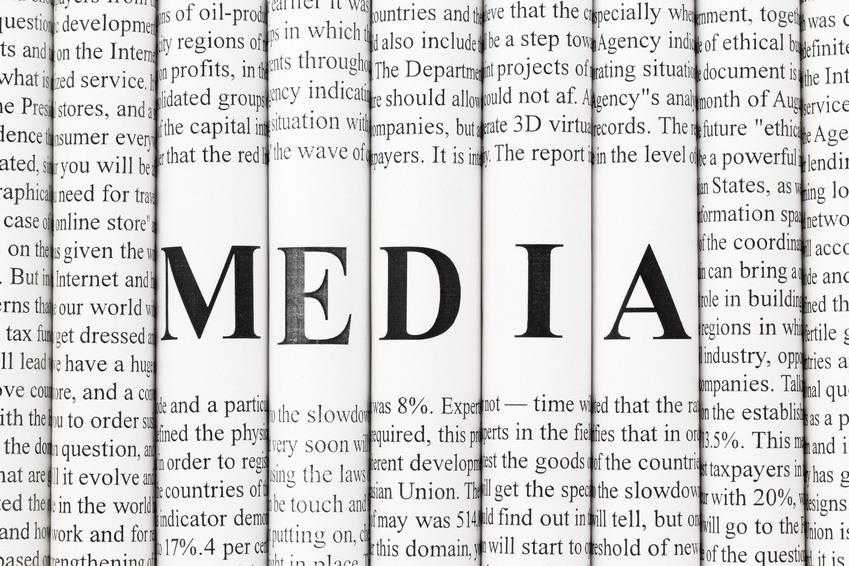"""Stack of newspapers with small text and big letters forming together word """"MEDIA"""""""